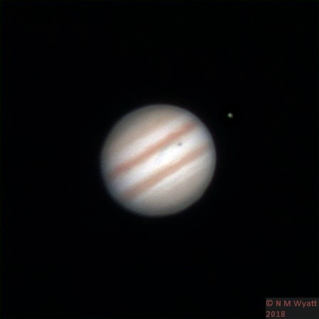 Jupiter and the moon Io, casting its shadow on the gas giant.