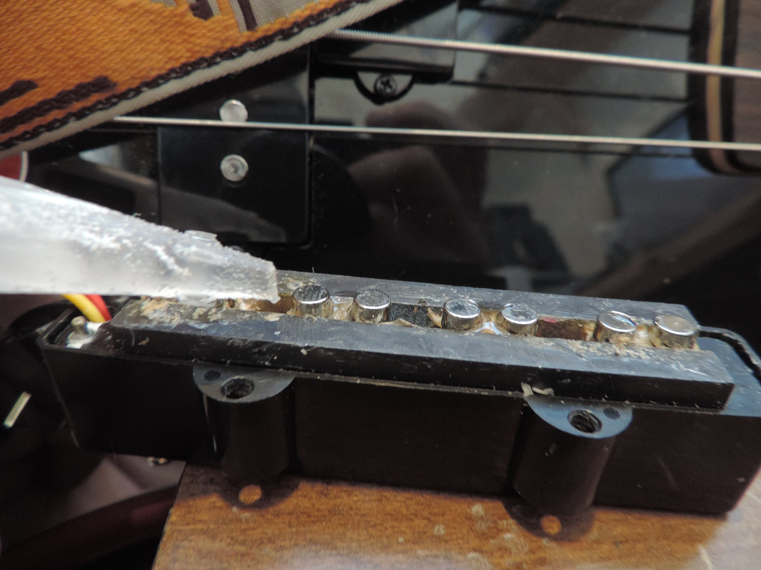 Gluing magnets in place on the pickup